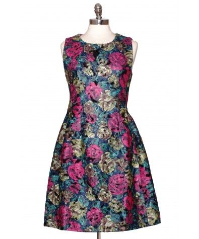 "The fabrics blend of polyester and viscose create a knit effect. Beautiful roses print in pink, green, blue and brown combined with secret zippers on the sides (open up to pockets) all form the perfect party dress. Tight on top and ""heavy"" on the bottom. Dress is fully lined."