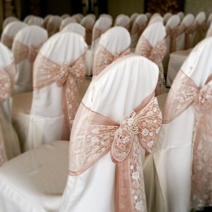 Dusky pink & lace chair covers with pearl brooch accent from @cakeywakey