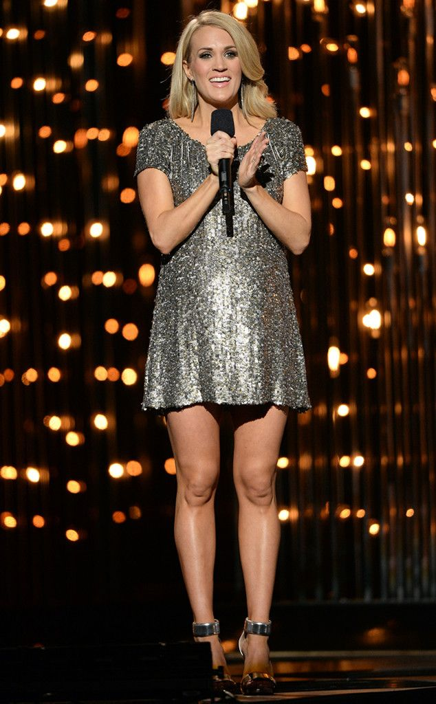 Metallic Bump from Carrie Underwood's Pregnancy Style  And she changes again! This time the CMA Awards host opts for a chic metallic mini.