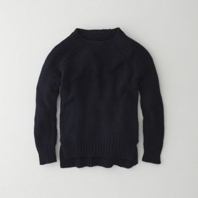 A classic cotton knit pullover sweater with raglan sleeves. Twist side seam detail with slits at the hem, and a longer shirt tail hem.    • crew neck  • rib-knit neck, cuffs, and hemline  • 100% cotton  • machine wash