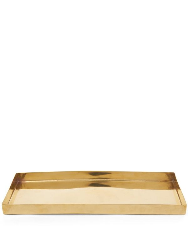 Combining functionality with a hint of decadence this Nordstjerne tray made from brass is inspired by the rawness of the Scandinavian and Nordic landscapes.