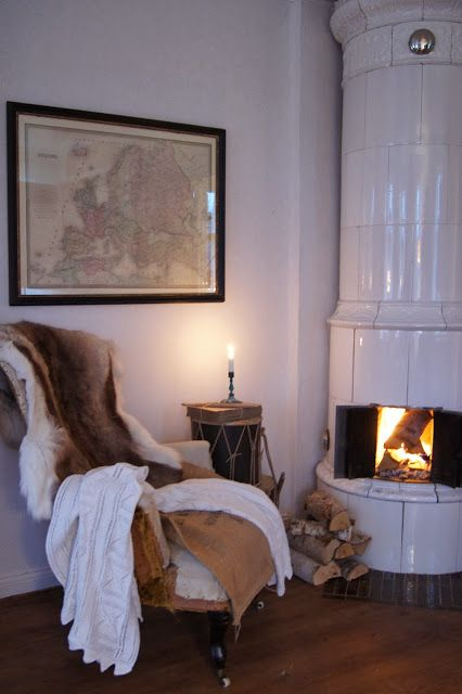 Lovely chair with animal hide throw by this cosy fire. #snugspot