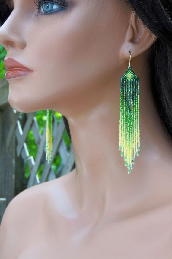 The colors of these unique earrings blend together perfectly and they are made to last! Three shades of green and two shades of yellow seed beads make up these handmade ombre earrings. The fringe includes small Swarovski crystal for a bit of extra sparkle. They are just shy of 4 1/2 long (including the handmade gold ear-wires); 3/4 wide and are super lightweight. I used brick stitch (also known as cheyenne stitch) to make these earrings; they are my own pattern. * Ready to ship - rush…