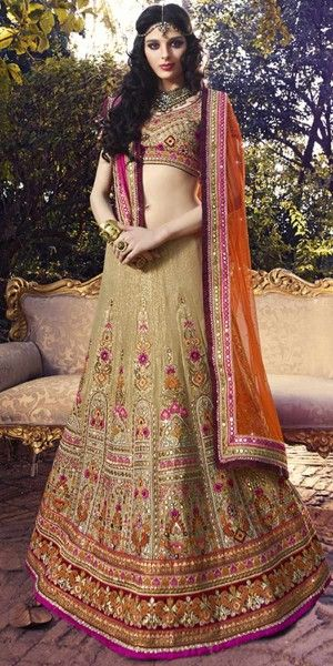 Dashing Cream And Orange Silk Designer Lehenga Choli With Dupatta.