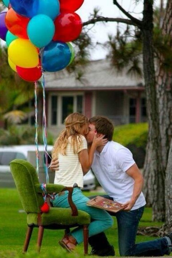 """An """"Up"""" proposal: He sat her in a chair with balloons then gave her a personalized adventure book"""