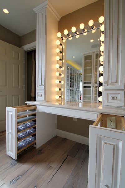Built-in vanity is nice. Pillars add a nice touch. And if you notice, there is an electrical outlet inside the drawer... for hair elements and such. Great idea. To be propped with a cute stool. -A