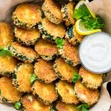 Crisp Zucchini Bites with Garlic Aioli Dip I want to try these with egg whites and baked instead of fried!!