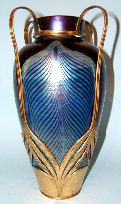 A stunning Loetz and Osiris art nouveau vase c1900. Peacock feather decoration in petrol blue on a purple iridescent ground.
