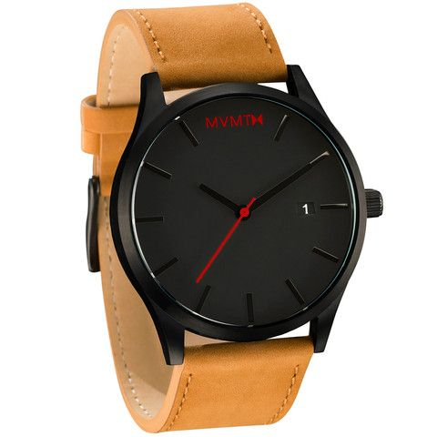 Men's black faced tan leather watch from MVMT. Black faced watch comes with three choices in straps. This tan leather version is a versatile watch, fitting in casual, formal and professional settings.