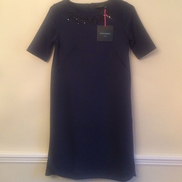 """NEW Cynthia Rowley Navy Dress Size 2 FINAL PRICE New with tags, navy dress with black crystals around neckline. Slit on each side is Approx 3"""". 94% polyester and 6% spandex. Machine washable. From top of back zipper to bottom of hemline is 33"""".  Excellent quality. Size 2 Cynthia Rowley Dresses"""