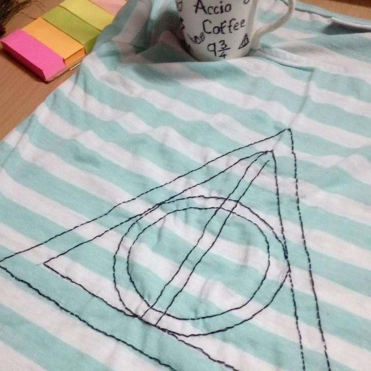 Hand-sewn 'deathly hallows' symbol on a t-shirt.. Sketch the design on the t-shirt and use your favourite embroidery pattern..