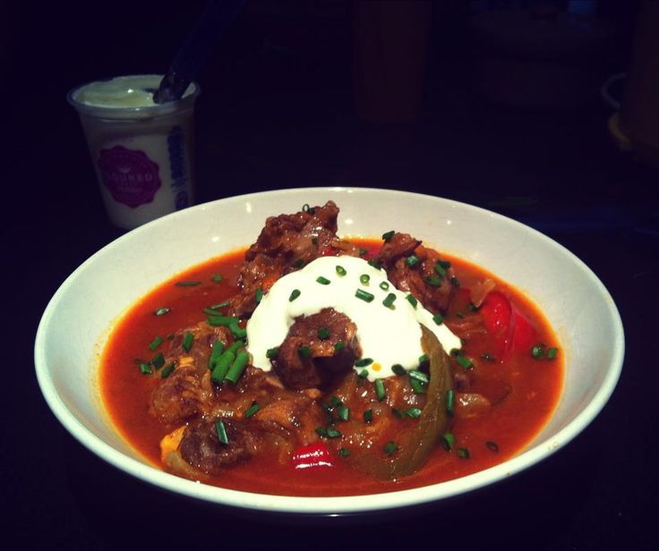 Hungarian Lamb Goulash topped with sour cream and chives