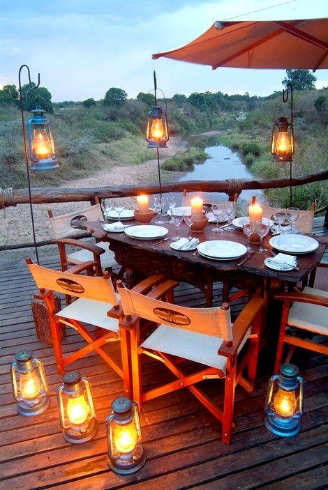 A romantic dinner setting overlooking the Talek river at the Mara Explorer Camp, Masai Mara, Kenya.