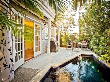 Key West house rental - The private back deck and the pool, with its unique Endless Swim feature