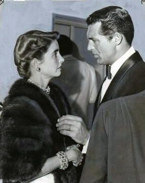 """As World War II threatened in 1939, Barbara Hutton moved to California. In Hollywood, she met & married Cary Grant, one of the biggest movie stars of the day. The married couple was dubbed """"Cash & Cary"""". Grant did not need her money nor to benefit from her name, & appeared to genuinely care for her. Nevertheless, this marriage also failed. Grant did not seek or receive any money from Hutton in their divorce settlement."""