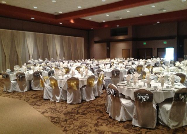 Wedding linens in light yellow canary and grey sashes ties on white chair covers with grey runners Northwest Indiana chair cover rentals at Halls of St George Schererville Indiana
