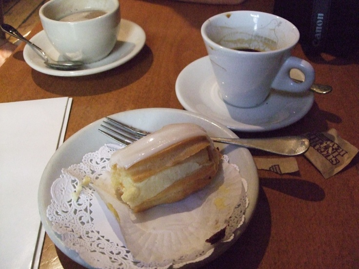 Cream cake with icing and coffee, cafe, New York.