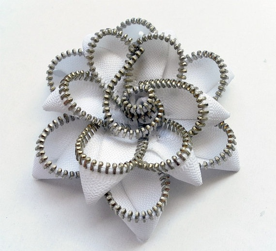 zipper flower.  this isn't a tutorial but after staring at it for a while I think I can figure it out with some older zippers I've been collecting