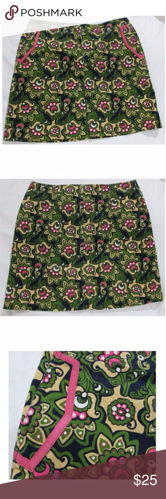 """Lilly Pulitzer Green/Pink Floral Corduroy Skirt This Lilly Pulitzer skirt features a floral print with pink trim at the pockets. It has a slightly A-line cut and secures in the back with a zipper and button. It is made of a light corduroy material (not too thick) that is slightly stretchy, but the waistband does not give very much. There is a pleat at the front of the skirt.   Excellent condition.  Size: 4 Across, at waist: ~15"""" Across, at bottom hem:~ 22"""" Length, measured down middle of…"""