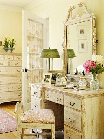 Distressed to Be the Best · Yellow walls complement the warm tones of the furniture and floor, and green and pink complete the serene palette.
