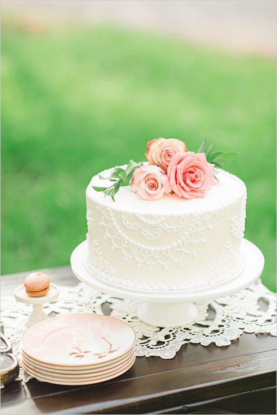 white wedding cake with peach roses #weddingcake #simplecake #weddingchicks http://www.weddingchicks.com/2014/02/25/rustic-ritzy-ranch-wedding/
