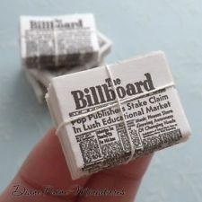 Stack of Billboard Newspapers Tied with a String - Dollhouse Miniature