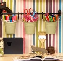 Storage ideas for your craft room, with IKEA items. I. Like this rail and pail idea for commonly used items, and it gets stuff off your table or desk surface
