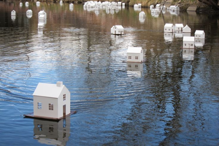 """Stephanie Beck - Art paper - Little Houses Projects, Fort Collins, CO: January - April 2011 - Runoff: Cache la Poudre,"""" 2011, cut paper, cardboard, tape, individual house dimensions vary around 12 x 10 x 12 in."""