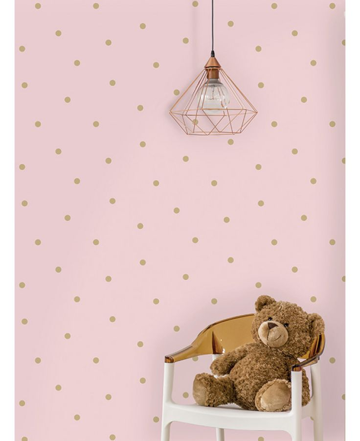 This Dotty Wallpaper features a simple yet striking metallic gold polka dot pattern on a soft pink background with a lightly textured matte finish. Free UK delivery available