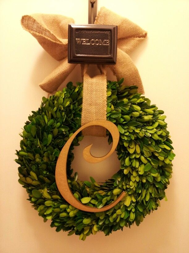 My DIY monogram Christmas wreath. Freeze-dried boxwood wreath (West Elm), gold initial (Craft Cuts), burlap ribbon (AC Moore) and engraved door hanger (Pottery Barn).