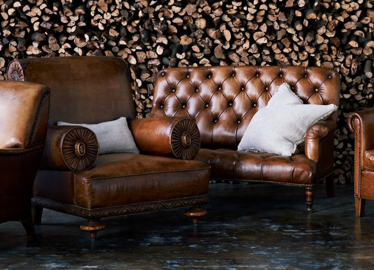 Tufted Settee and rolled armchair.  The detail on the chair arms, base, and those front legs are amazing!    Ralph Lauren Home - RalphLaurenHome.com