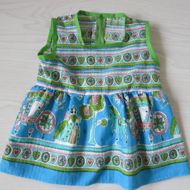 Dress for a 2-year old made of recycled material (old apron).