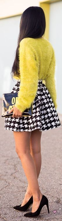 i love this classy yet funky look. The pop of yellow color is enhanced by the black and white print of the skirt. The flare of the skirt compliments the sweater for an overall classy chic look! so hot!