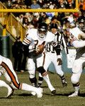 Chicago Bears Hall of Fame running back Walter Payton (34) using the block of running back Dave Williams (22) during a 15-14 Bears victory on December 9, 1979, at Lambeau Field in Green Bay, Wisconsin. (Don Lansu/NFL)