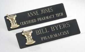 """Black Brass Namebadge w/ Mortar & Pestle Logo Item H015 Make a professional statement with our contemporary namebadges featuring easy-to-read engraving and attractive designs.  Name tag arrives boxed with both a pin back and magnetic back.  Approximately 3/4""""H x 3""""W."""