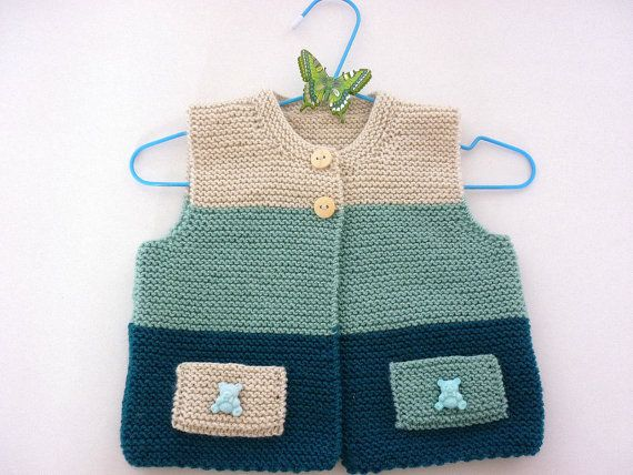Soft cardigan hand knitted suitable for both boys and girs. It is hand knitted in wool & acrilyc. It is perfect for everyday wear. It has wooden buttons and two small pockets with decoration. length - 28 cm/11  width -25cm/10  Size : 6-12 m The design is the work of AnaSwet .You receive the cardigan in handmade packaging and beautiful card. All items are unique in design and handmade in a nonsmoking environment. All used materials have been carefully selected with regard to quality and…