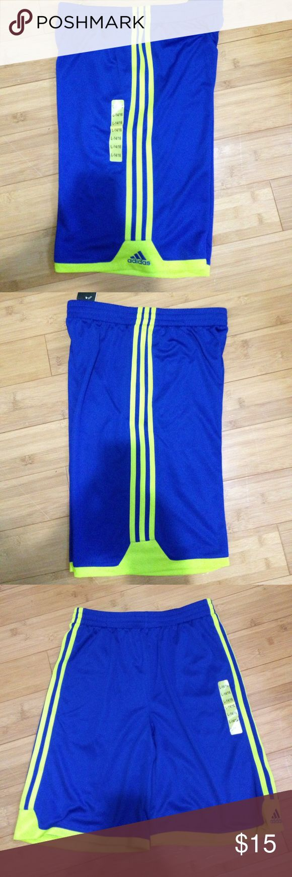 "Adidas NWT Blue & Neon Green Shorts New with tags These are a Size Large(14-16) women's Basketball Shorts. They measure 21"" from waist to bottom, inseam is 10"", waist laid flat and un-stretched is 14"", elastic waist with a drawstring. No pockets Adidas Shorts"