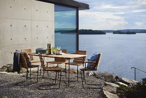 Grinda chair, teak, black metal frame. Grinda table 150 cm, teak, black metal frame. Design: Matilda Lindblom. Photo: Johan Carlson