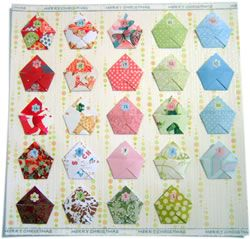 Have you tried Origami?  This is a sweet Advent calendar using the ancient Japanese paper-folding technique.  Aren't these pockets the cutest?