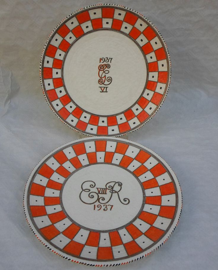 Two 1930s Crown Ducal wall plaques, designed by Charlotte Rhead in the 4724 Coronation pattern, each having a tube-lined decoration depicting the royal cyphers for Edward VIII and George VI within an orange check border, printed and tubed marks verso to include the facsimile Rhead signature on both, each 36.5cm diameter