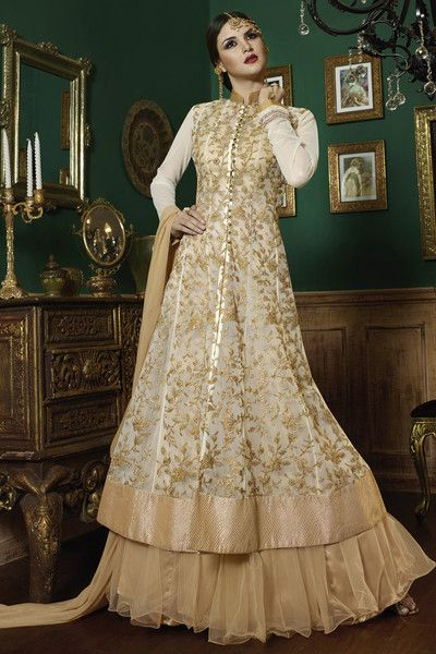 Add more lavishness to your bridal look with this scintillating indo-western bridal wear embroidered lehenga choli. This beige color designer sharara top leheng