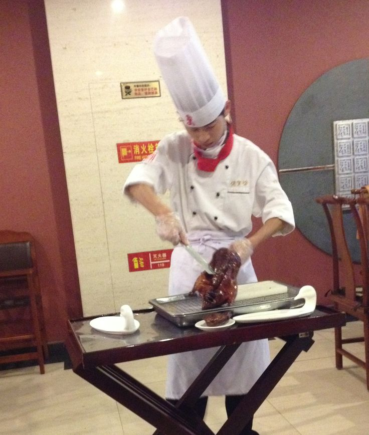 Carving the famous Peking Duck at a fine restaurant in Bejing
