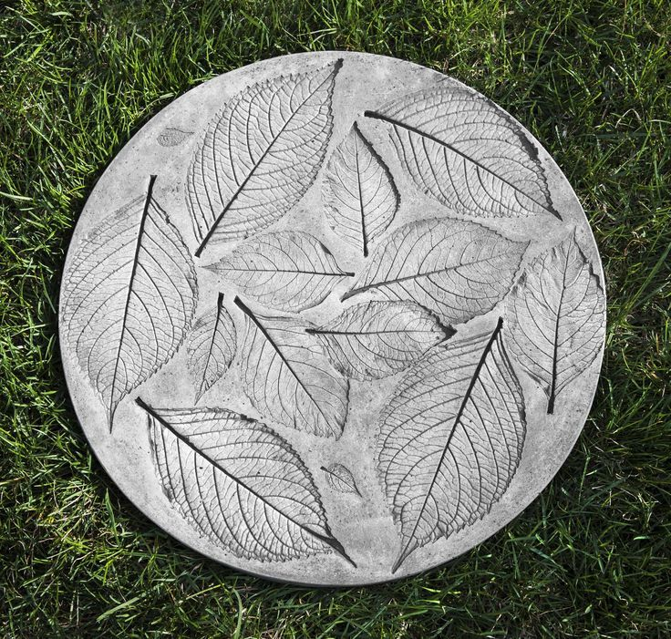 Features:  -Material: Cast stone.  -Patina or finish hand applied by trained artisans.  -Designed to weather naturally and last a lifetime.  -Made in the USA.  Product Type: -Stepping stone.  Style: -