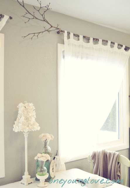 Branch curtain rod, tab curtains, only bright purple not white - one layer a solid light purple stretchy fabric, and then another layer over that of sheer see-through sparkly brighter purple.