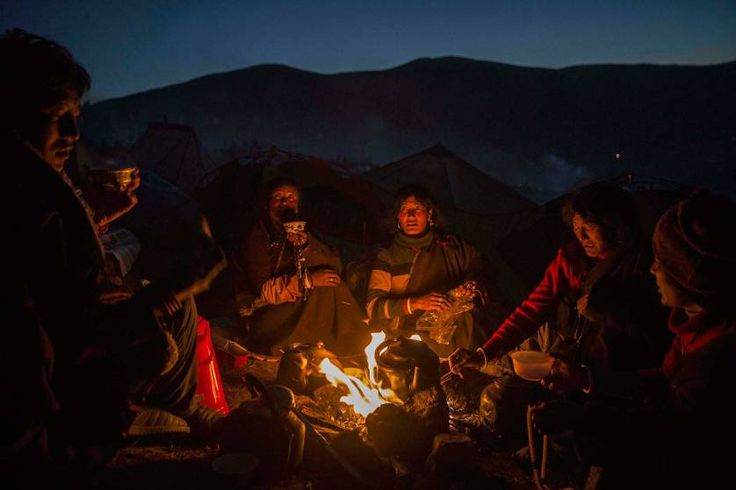 Daily Life, 2nd prize stories. Tibetan Buddhist nomads cook by candlelight in Sertar county, Garze Tibetan Autonomous Prefecture, Sichuan province, China, Oct. 31, 2015.