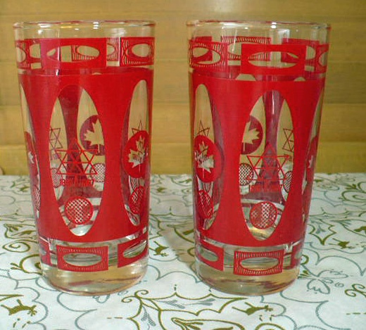 These are Swanky Swigs from 1967 which celebrate Canada's centennial year. They once held cheese spread and had metal lids. The lids and the cheese are long gone but the glasses remain in excellent vintage condition with their bold red color. They each have the Centennial logo with 1867 - 1967 and the Maple Leaf design.  These pieces are in excellent vintage condition.    http://www.etsy.com/shop/VintageatElsiesPlace