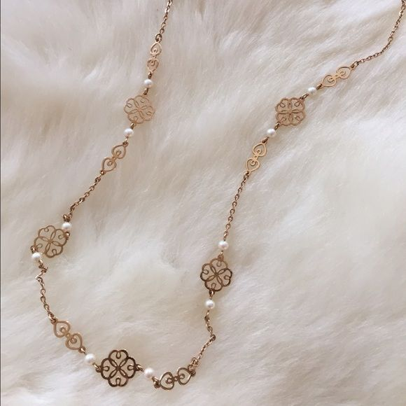 Clover & Pearl Necklace Beautiful Filagree clover design with pearls. Nice Longer length, good for sweaters! Faux gold and faux pearls (I believe) Jewelry Necklaces