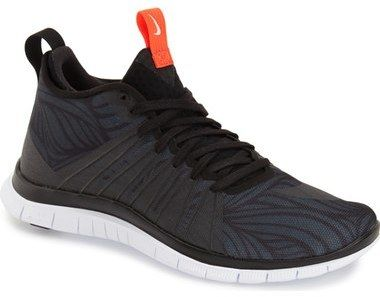 An eye-catching fusion of tech construction and street style, this hot sneaker offers a double-barrel blast of on-point appeal. Lace-up style. Textile and synthetic upper/textile lining/rubber sole. By Nike