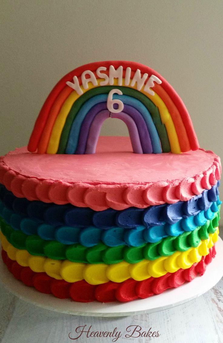 Rainbow birthday cake with rainbow topper and colored buttercream icing. facebook:heavenlybakesaltona