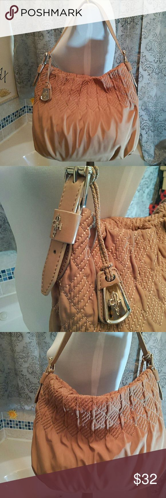 "Cole Haan tan fabric shoulder bag adorable bag with rows of smocking design around the top; silver hardware; microfiber fabric in a medium tan color; 1 strap with belt buckles on each end so length can be adjusted as needed; zipper on top; inside is a satiny mauve fabric with tan trim - minor ink marks; usual zip and slip pockets; large size 14""x11""dingy on bottom and 1 small mark - please see pics  GUC  (B-1) Cole Haan Bags Shoulder Bags"